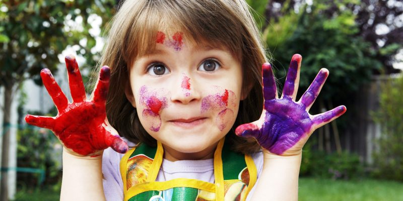 Young girl with painted hands and face